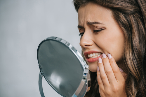 Woman with wisdom tooth pain